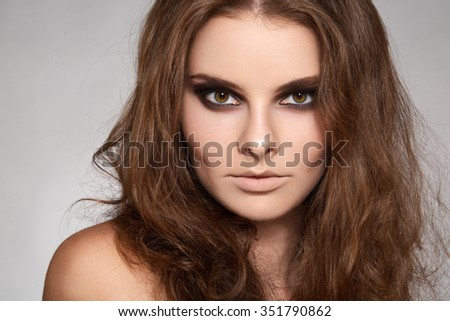 Lovely model with shiny volume curly hair - stock photo