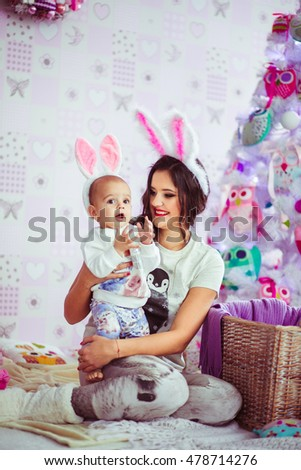lovely mom and cute baby in a rabbit suit
