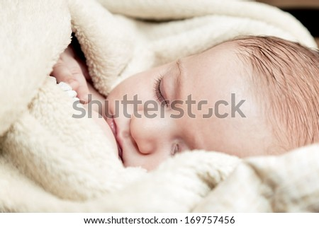 Lovely 3 months baby sleeping in soft blanket, close up face portrait - stock photo