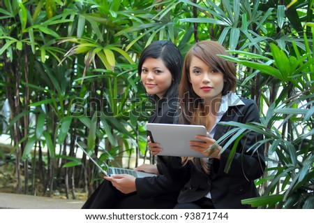 Lovely of young Asian businesswoman take rest with laptop while office break - stock photo