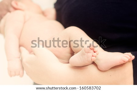 Lovely portrait of a father and newborn baby  - stock photo