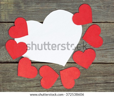 lovely red hearts - big white Heart hanging on the clothesline. Space for info text. On old wooden background. Romantic date, love Valentines Day concept. blurred - stock photo