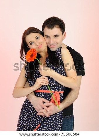 lovely romantic man giving flower to a woman