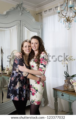 Lovely sisters hugging each other