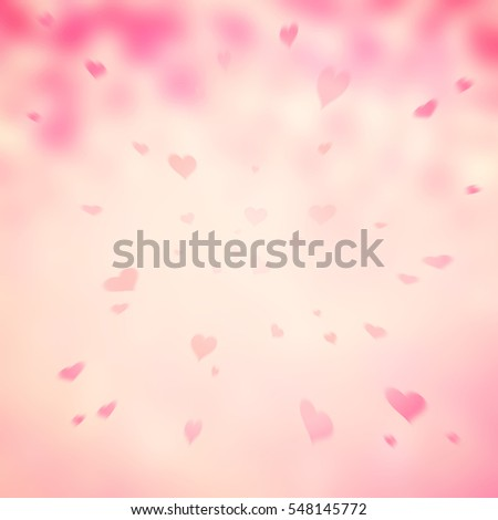Lovely soft pink colored abstract motion blurred heart symbols copy space illustration background.