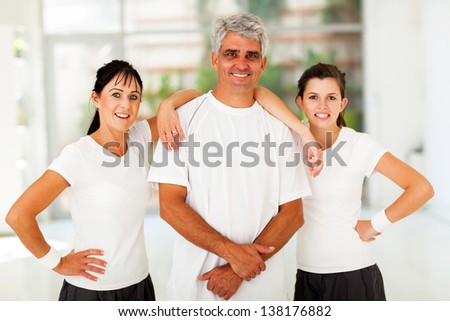 lovely sporty family of three portrait at home - stock photo
