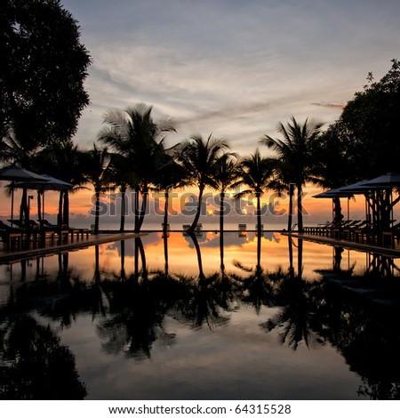 Lovely sunset over the infinity pool. Gulf of Thailand. - stock photo