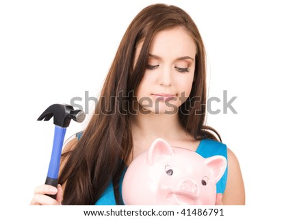 lovely teenage girl with piggy bank and hammer - stock photo