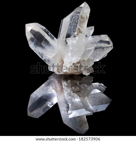 Lovely terminated white Quartz, Rock Crystal with reflection on black surface background  - stock photo