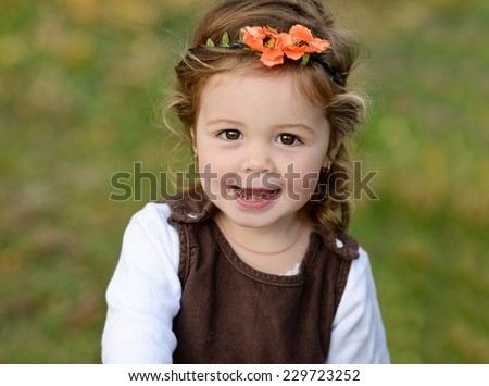 lovely toddler girl with happy smile - stock photo