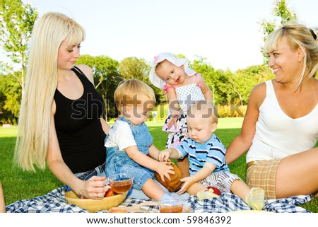 Lovely toddler kids eating cake, mother looking at them - stock photo