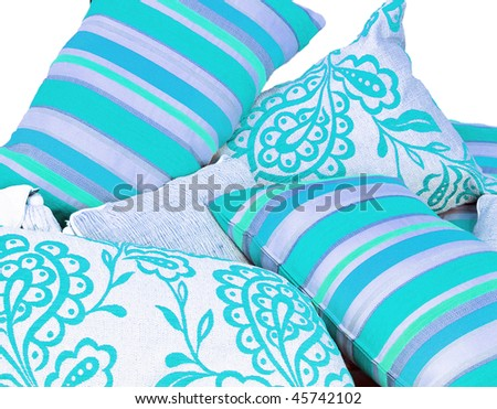 Lovely turquoise blue cushions in variations on a pure white background with space for text - stock photo