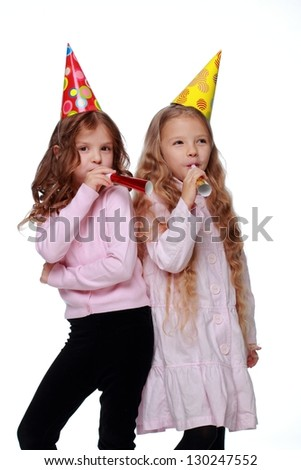 Lovely two little girls in casual wear on white background