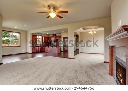 Lovely unfurnished living room with carpet, and fireplace. - stock photo