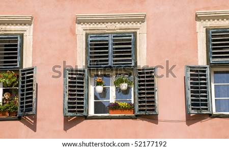 lovely view, flowers in the window - stock photo