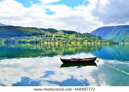 Lovely view of a fjord and a boat in Ulvik, Norway.