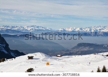 Lovely view of the valley in the Dolomites on the slopes in the background panorama of snowy mountains. Skiing on the Dlomites, Italy. - stock photo