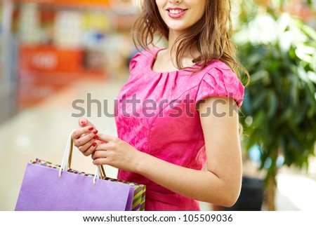 Lovely woman doing shopping on her day off