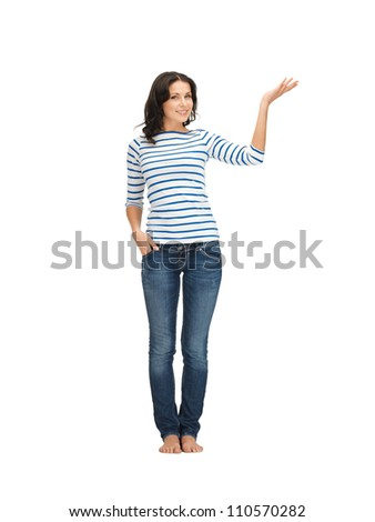 lovely woman in casual clothes showing direction - stock photo