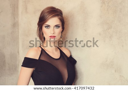Lovely woman in evening dress - stock photo