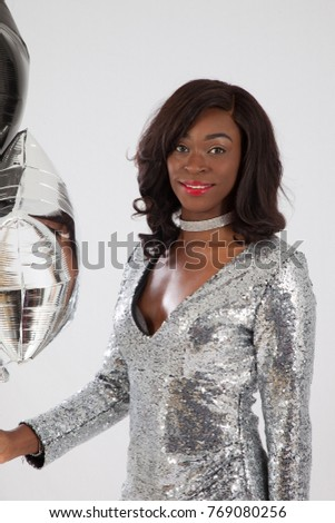 Lovely woman in silver dress with silver and black balloons