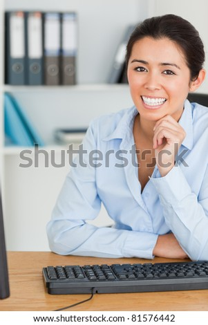 Lovely woman posing while sitting in the office