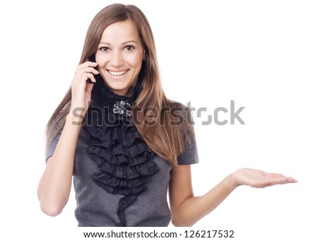 Lovely woman talking on mobile phone and holding something imaginary - stock photo