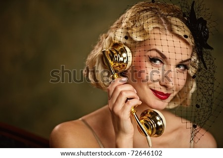 Lovely woman talking on the phone. Retro portrait - stock photo