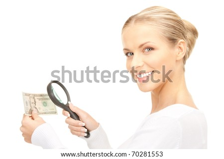 lovely woman with magnifying glass and money - stock photo