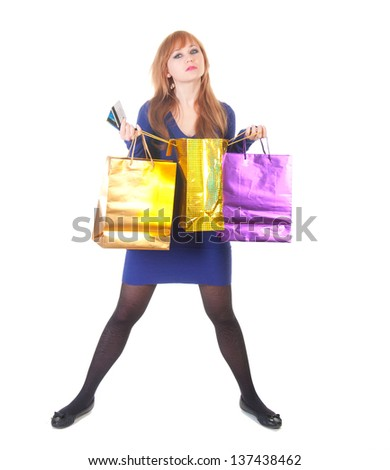 lovely woman with shopping bags and credit  cards over white background