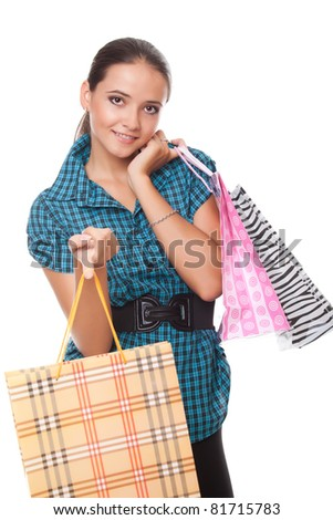 Lovely woman with shopping bags over white background - stock photo
