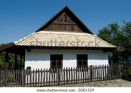 Lovely wooden house in the Unesco World Heritage village of Holloko, Hungary. - stock photo