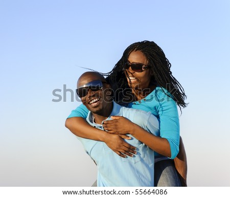 Lovely young African American couple together outdoors - stock photo