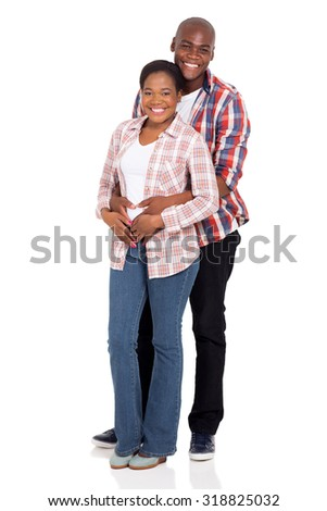 lovely young african couple hugging isolated on white background - stock photo