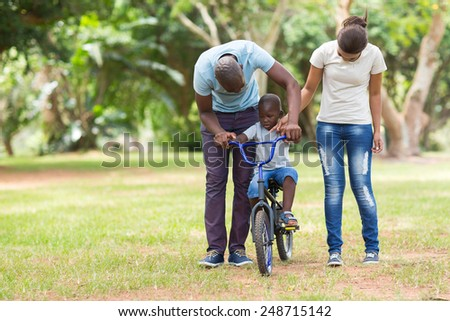 lovely young african family having quality time outdoors - stock photo