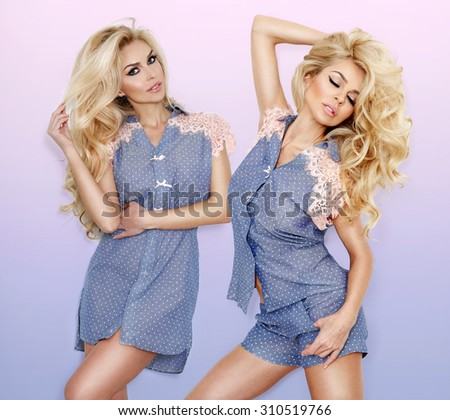 Lovely young blonde hair the woman is standing in pyjamas sexy smiling