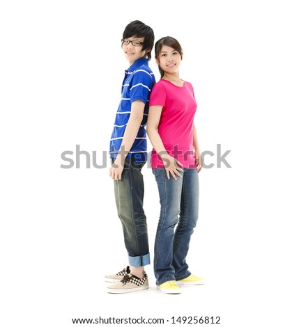 Lovely young couple back to back - stock photo