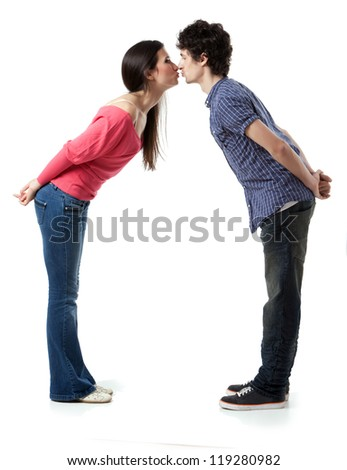 Lovely young couple having fun by pretending that are kissing.