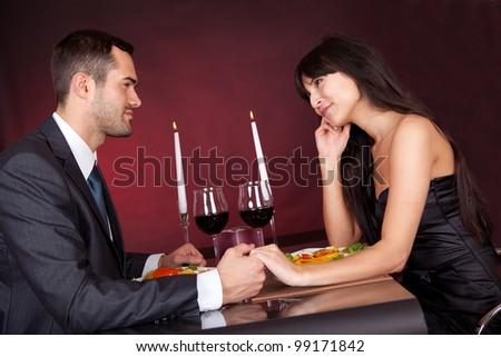 Lovely young couple having romantic dinner in restaurant - stock photo