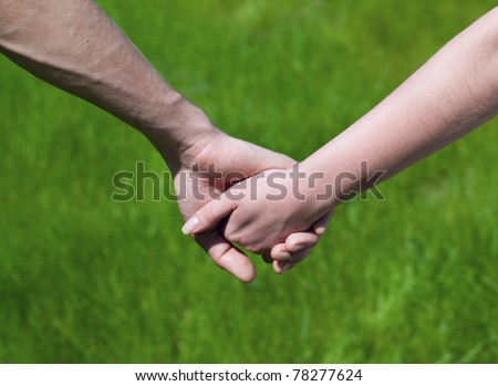 Lovely Young couple hold each other's hand - stock photo