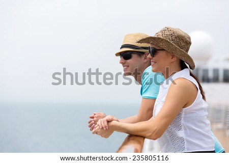 lovely young couple on cruise vacation - stock photo