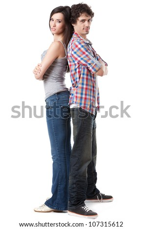 Lovely young couple sitting back to back. - stock photo