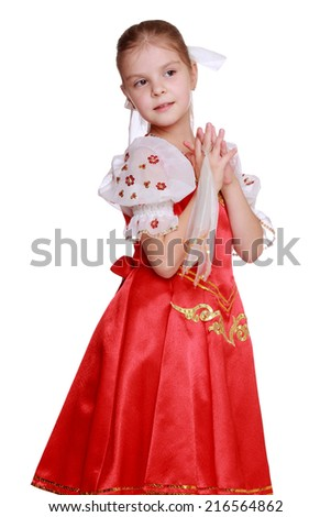 Lovely young girl dance in Russian national suit isolated over white background on Holiday theme/Pretty girl in Russian national dress