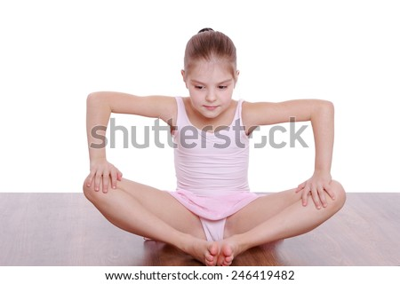 Lovely young girl doing gymnastics  - stock photo