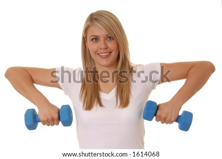Lovely young girl lifting weights