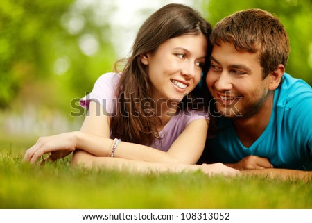Lovely young people relaxing in countryside - stock photo