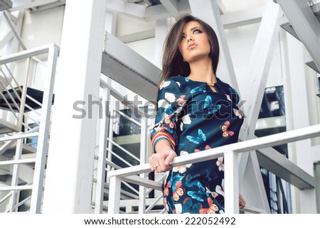 Lovely young woman in blue dress with butteflies  - stock photo