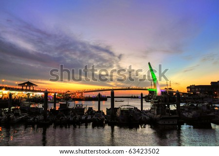 Lover's Bridge ,beautiful sunset , in danshui fisherman's wharf  Taipei, Taiwan (taiwan famous scene) - stock photo