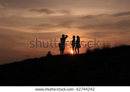 lover taking photo during sunset - stock photo