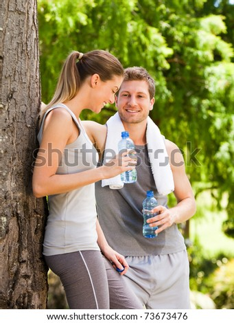 Lovers after the gym - stock photo